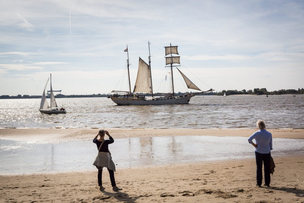 People watching sailing ship in Blankenese, Germany