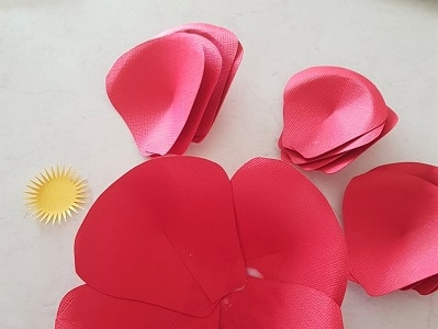Paper flower petals organised ready to glue together