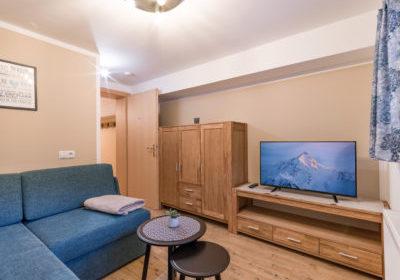 Appartements_Hof_Neuhaus_Burgstall_350_Mayrhofen_01_2020_Appartement_Winterzeit_Wohnzimmer