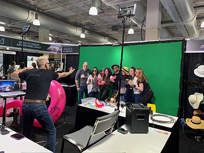 Photographer Mike Gatty poses a group of participants at this Phoenix green screen photo booth.