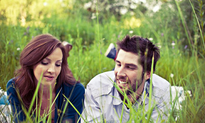Couple talking in grass