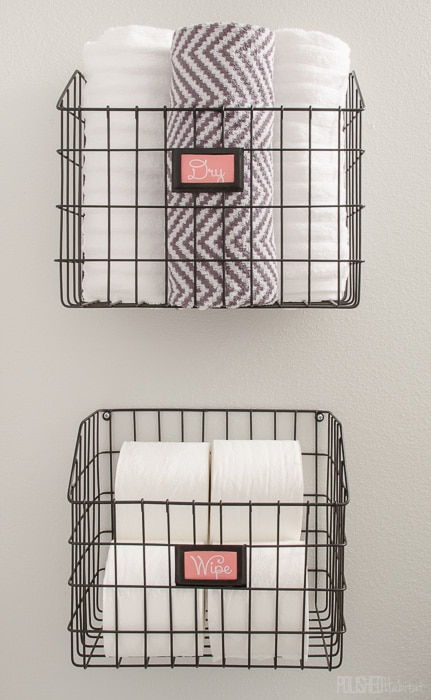 wire basket storage ideas for the bathroom-mount wire baskets on wall and use them to store towels and toilet paper
