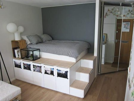 genius bedroom organization ideas- platform bed created out of Ikea cabinets