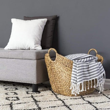 basket with blankets and pillows-bedroom organization ideas