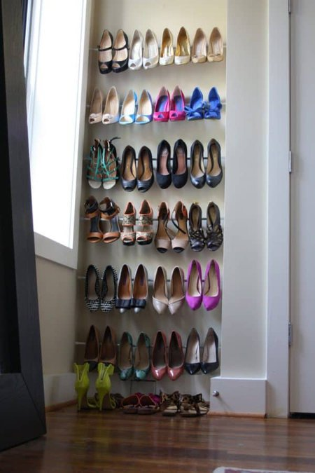 bedroom organization ideas-using tension rods for shoe storage in bedroom