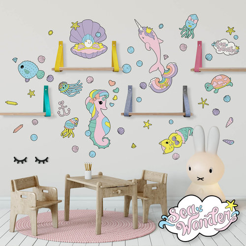 Sea creature wall decals in a girly playroom.