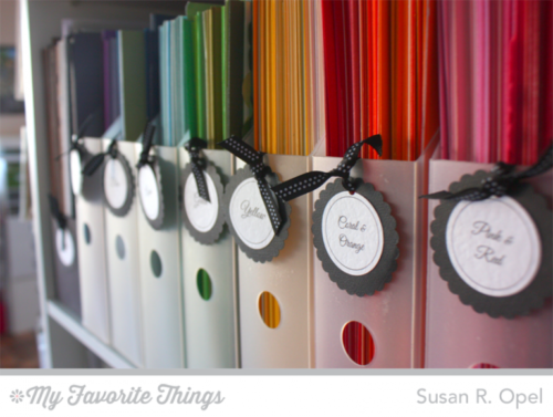 colorful paper in magazine holders organizing paperwork