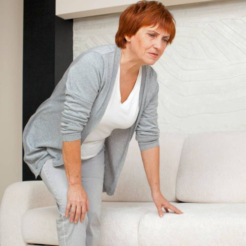 Woman Showing Signs of Achy Joints Arthritis Pain