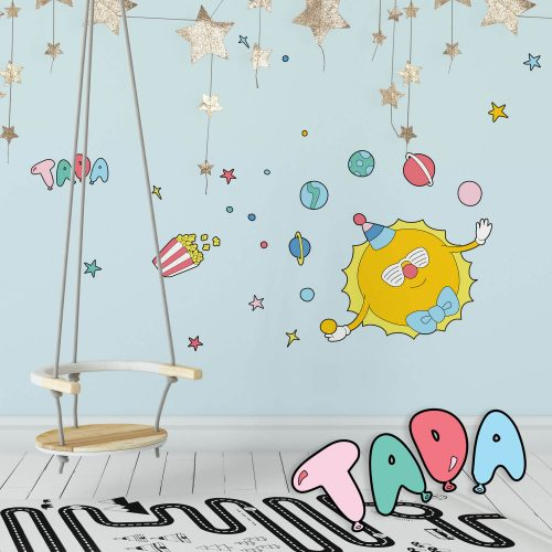 Circus Space inspired wall decals featuring a juggling sun in a playroom.