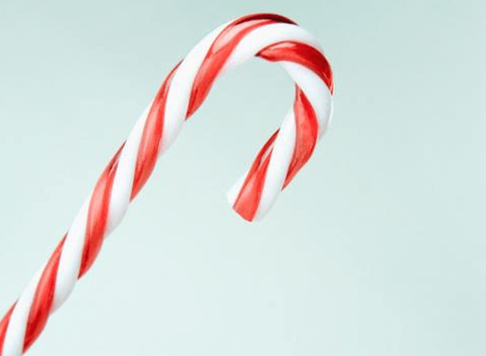 wallpaper showing candy cane in red and white color