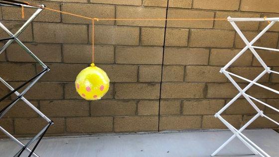 Yarn Pumpkin Hanging Between Racks