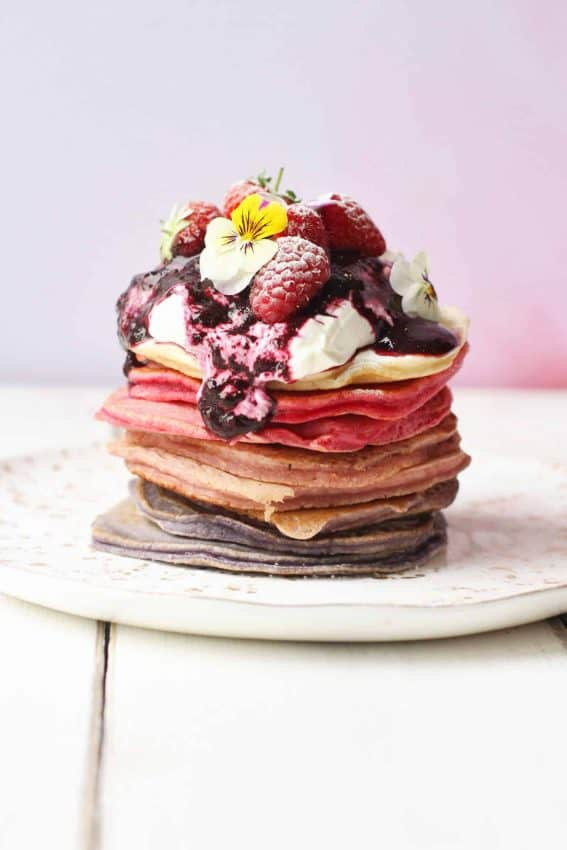 Ombreé berry pancake stack topped with greek yoghurt and fresh fruit