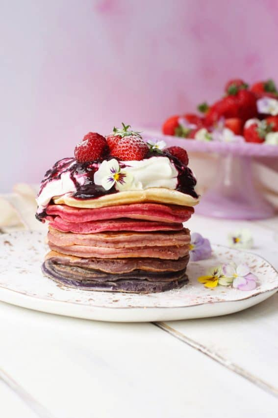 Ombreé pancake stack with fresh fruit in the background