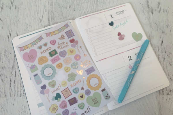 open Erin Condren Petite Planner with date night marked off