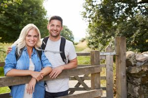 uk couple standing outside a gate in the uk countryside