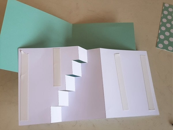 Picture of the double-sided tape ready to glue the main section of the Step Card to the backing.