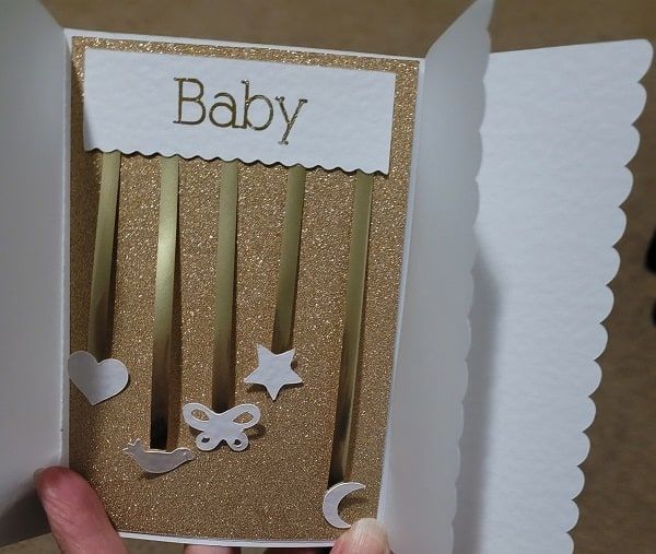 Inside of the quick baby card using gold glitter cardstock, gold foiled writing and vellum to make it extra special.