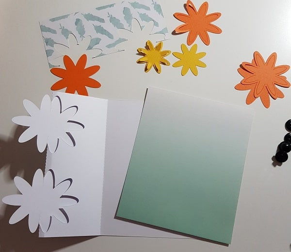 3D flower tri-fold card pieces cut out ready to put together.