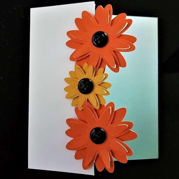 Finished 3D flower tri-fold card with button flower centres