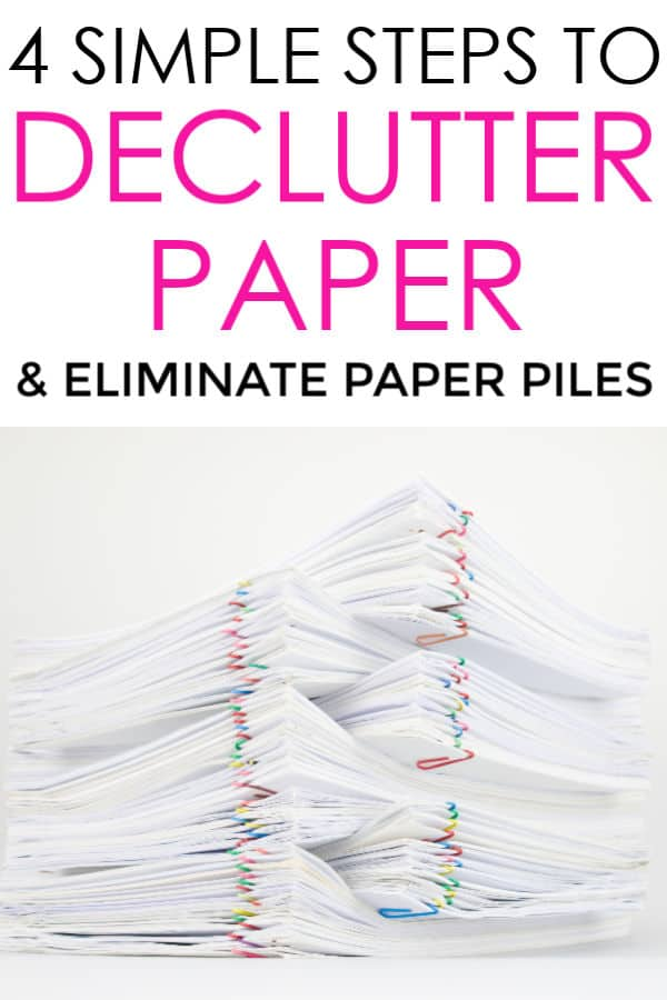 stack of white paper with colorful paperclips: declutter paper