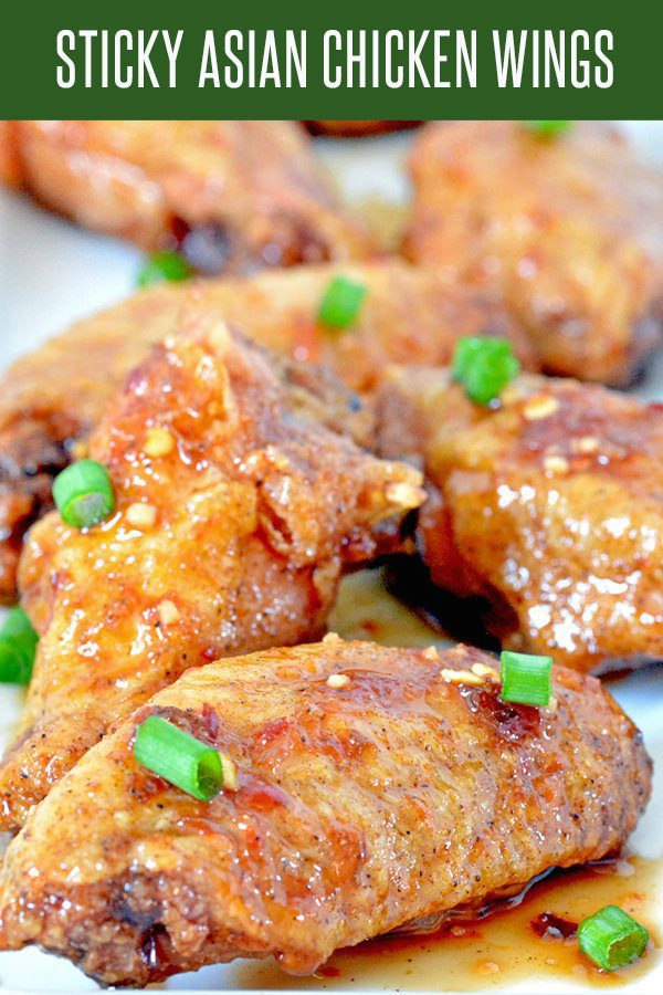 Sticky Asian Oven Baked Chicken Wings! Perfect recipe for football season or holiday parties! Crispy wings covered in honey, soy sauce and garlic. #chickenrecipes #chickenwingsrecipe #appetizerrecipes #asianrecipes