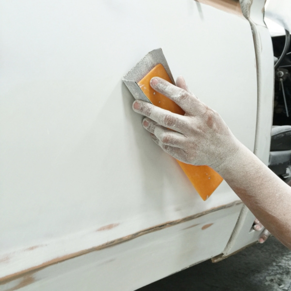 hand sanding a car panel resized