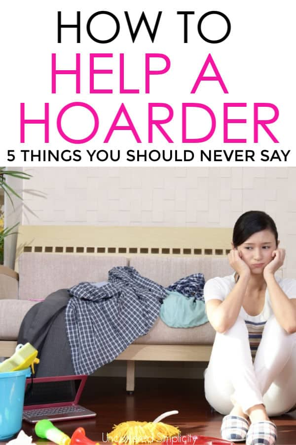 upset woman sitting on floor surrounded by clutter How to help a hoarder