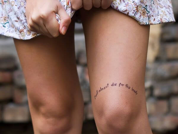 short quote tattoo above knee cap for girls