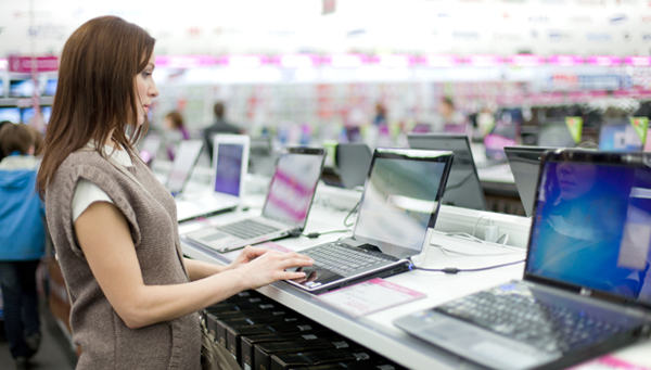 a lady shopping for computers