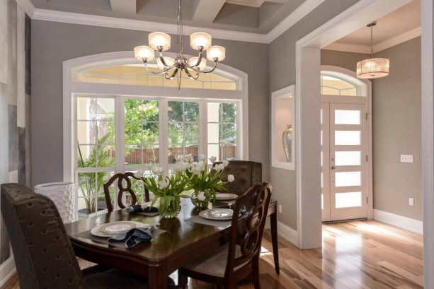 small and airy contemporary dining room with Sherwin-Williams ellie gray SW 7650 wall paint color