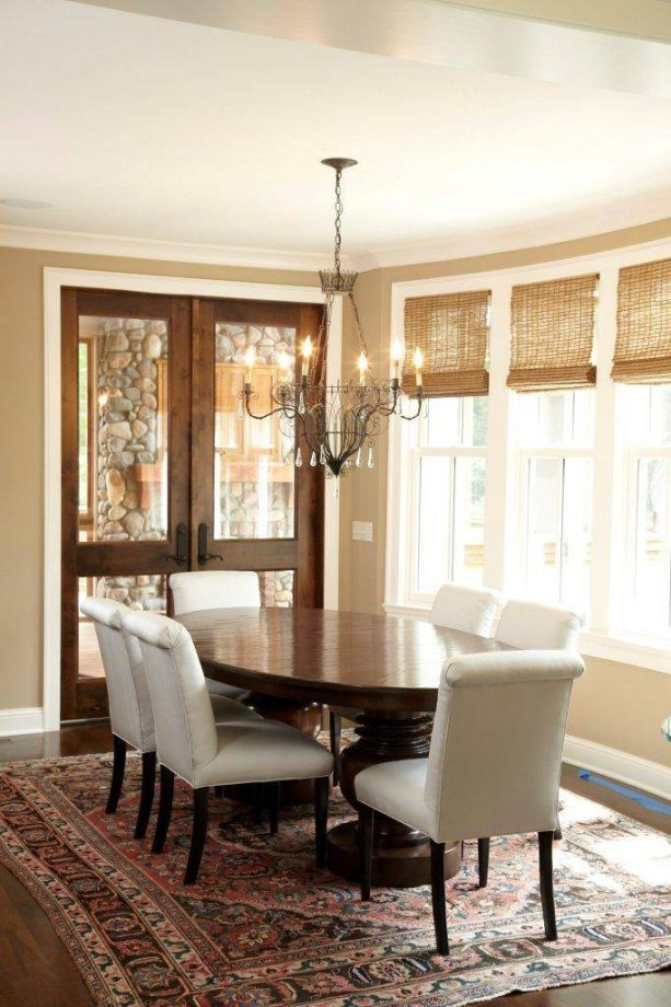 traditional dining room with wooden-glass doors and white trim
