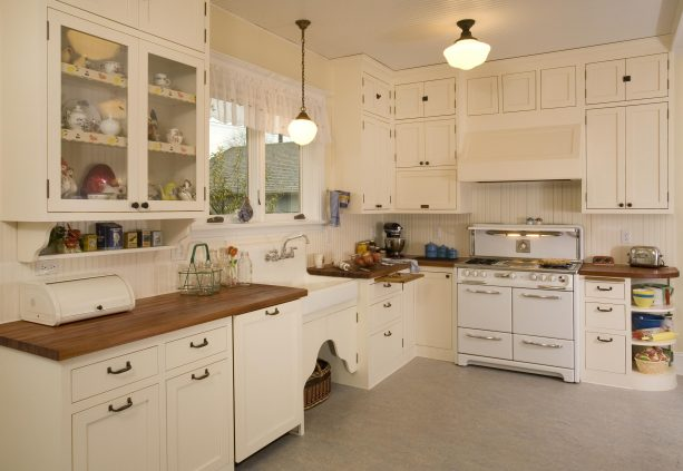 shabby chic kitchen with antique white cabinets and wood countertops