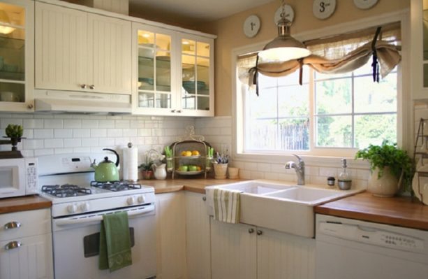 traditional farmhouse kitchen with antique white cabinets and butcher block countertops