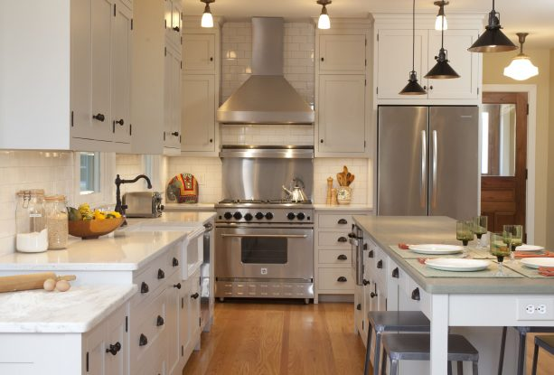 traditional kitchen with antique white cabinets and stainless-steel appliances