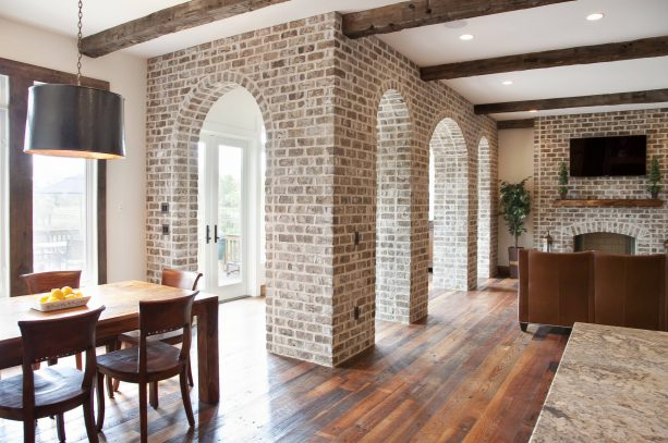 traditional kitchen interior with white-washed brick wall