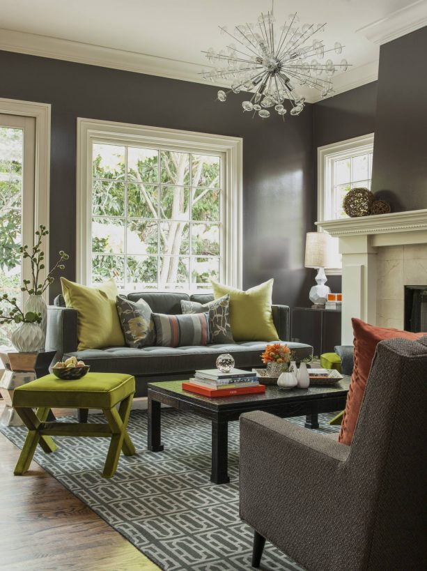 fun contemporary living room with ash gray wall and brown cedar sofa with olive green pillows
