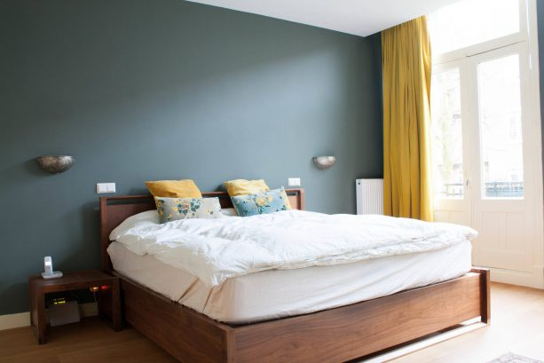 a bedroom with teal and mustard theme