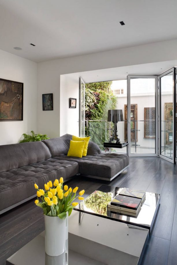 grey and yellow living room with fresh yellow tulips in light grey vase