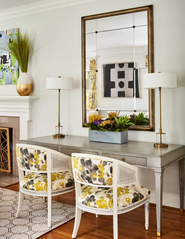 grey and yellow living room with yellow abstract floral-patterned chairs