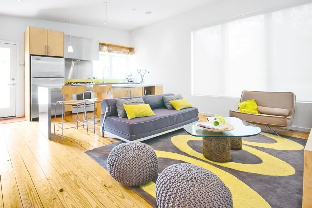 modern living room with grey and yellow oval-patterned rug