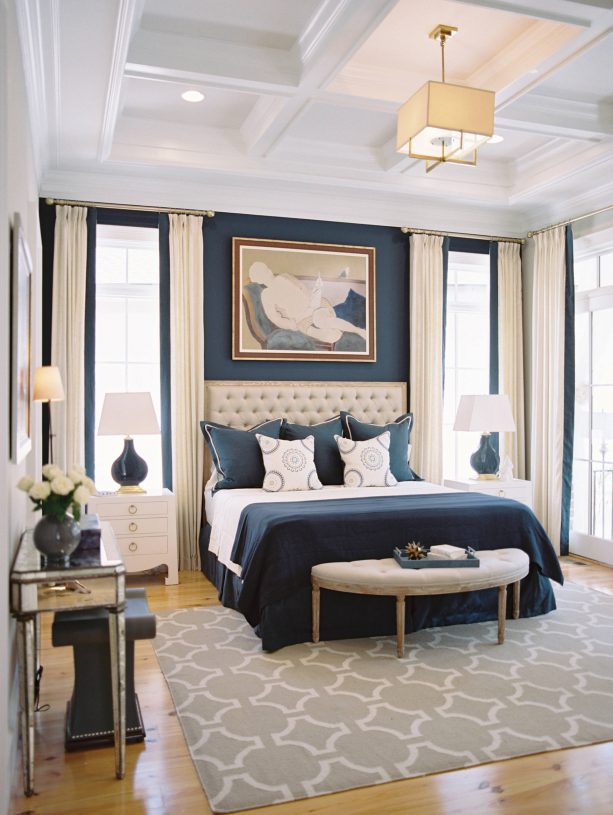 blue and grey bedroom with matte dark blue accent wall