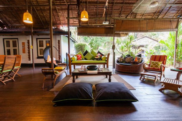 tropical porch with roll-up bamboo blinds to protect furniture from sun fade