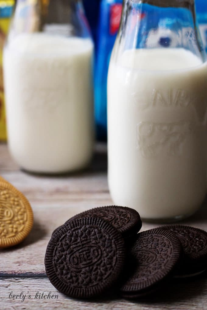 Pile of coconut OREOs with milk.