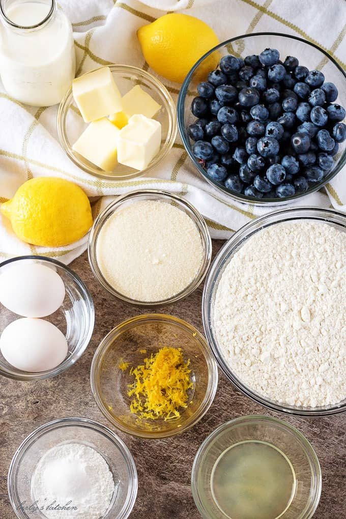 Top-down view of all the ingredients like fresh blueberries, lemon zest, butter, and eggs.