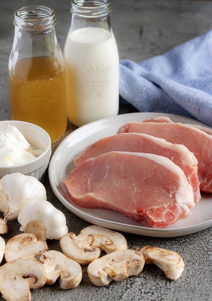 A photo of the Instant Pot pork chops ingredients like, fresh mushrooms, garlic, chicken broth, and sour cream.