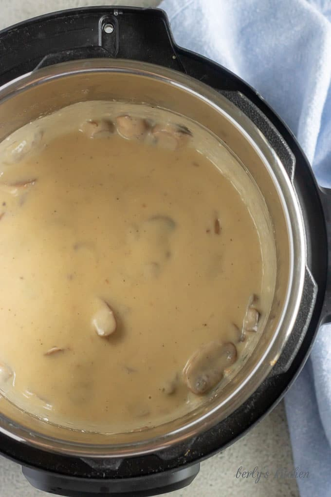 The last Instant Pot pork chops picture showing the finished mushroom gravy, just before the dish is served.