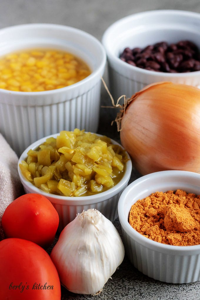 The photo shows the black bean chili ingredients like, beans, corn, tomatoes, garlic, and taco seasoning.