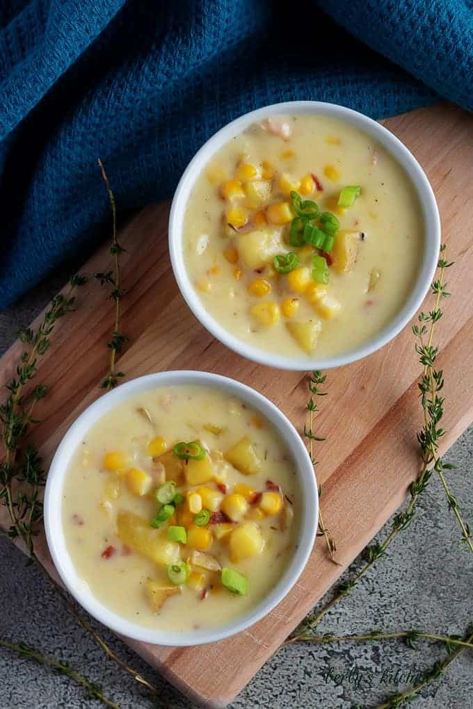 A top-down shot of the corn chowder with bacon, topped with diced green onions.