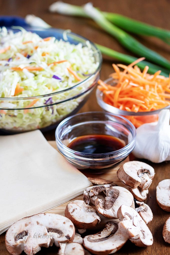 The homemade egg roll ingredients, like garlic, slaw, carrots, and ginger.