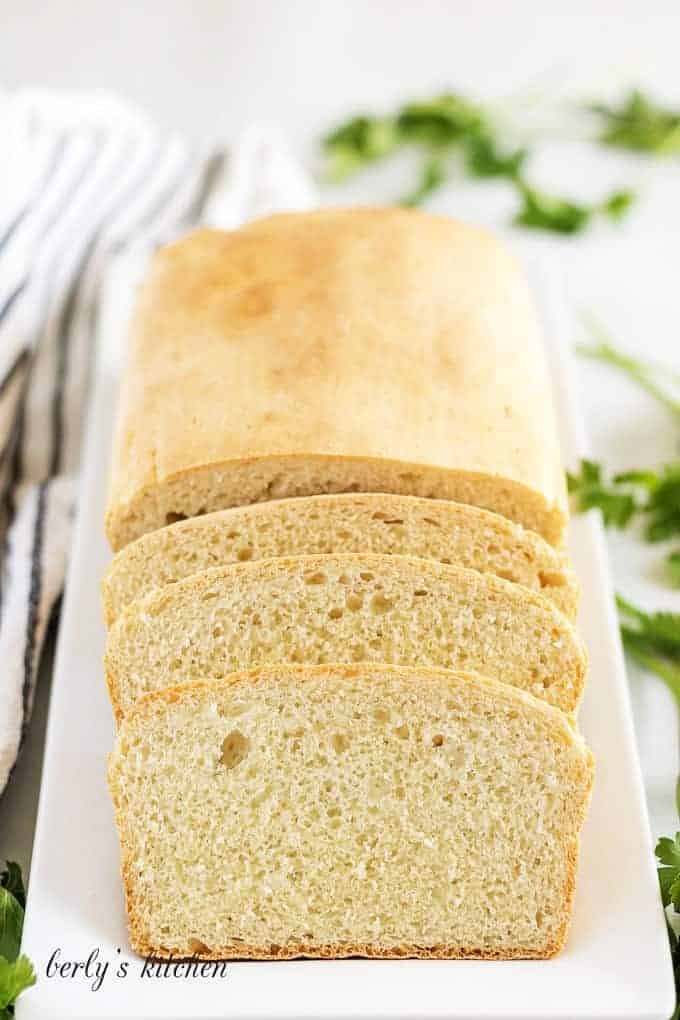 The finished English muffin bread on a rectangular plate.